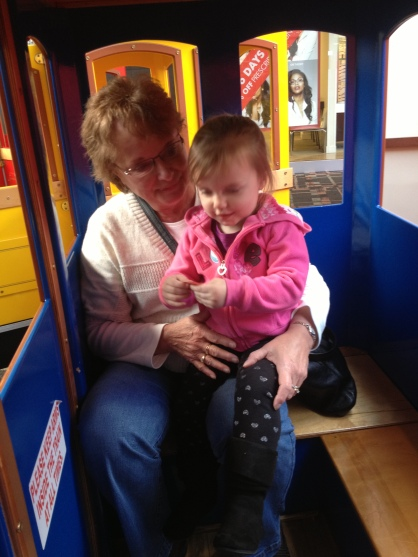 Elodie + Grandma on the train at the mall